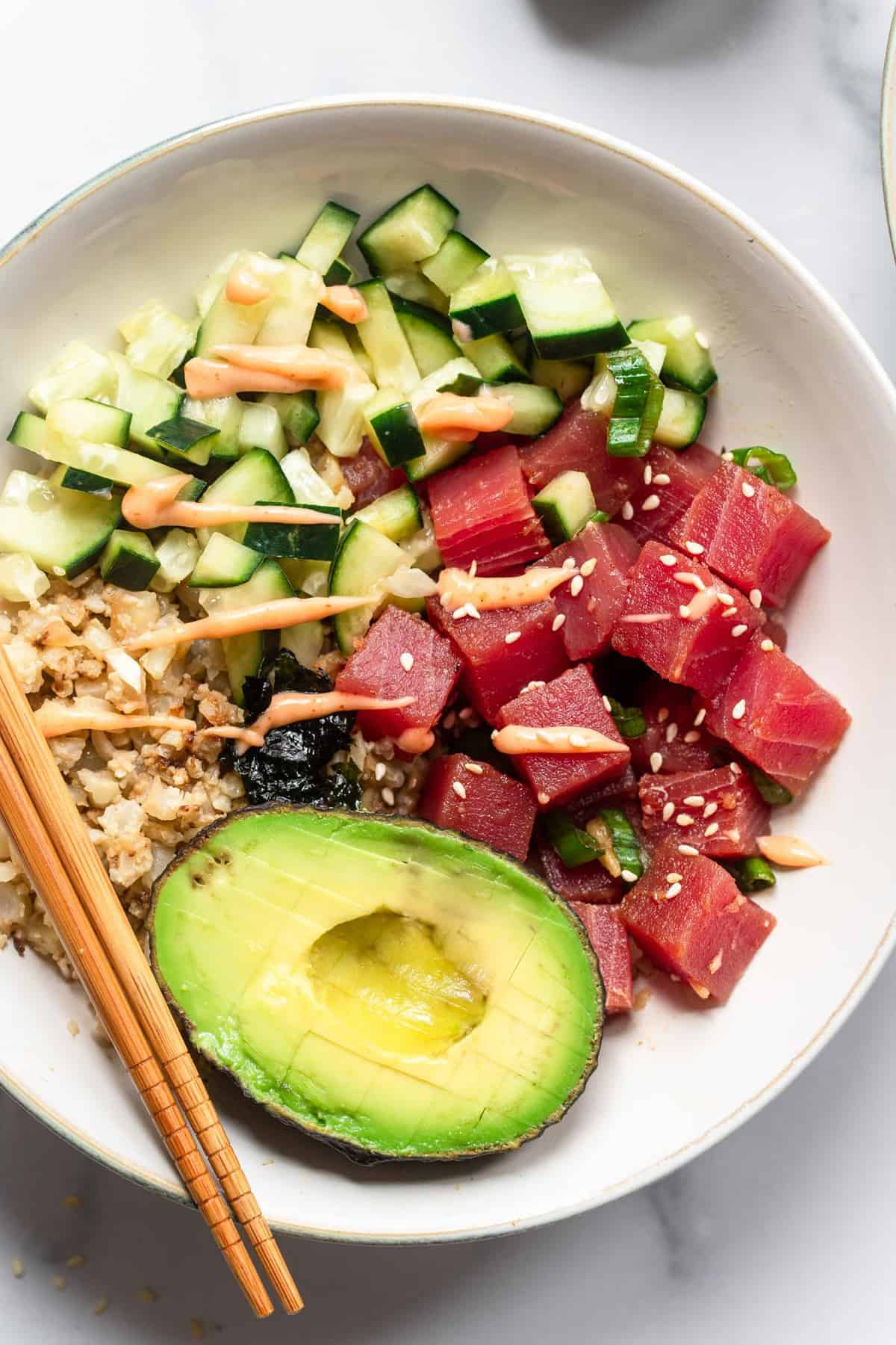 close up of low carb poke bowl in a bowl with chopsticks