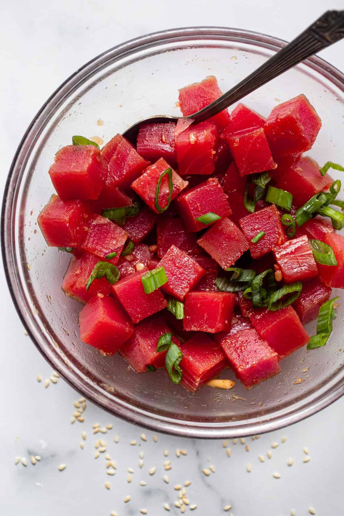 cubed ahi tune marinating in a bowl for low carb poke bowl