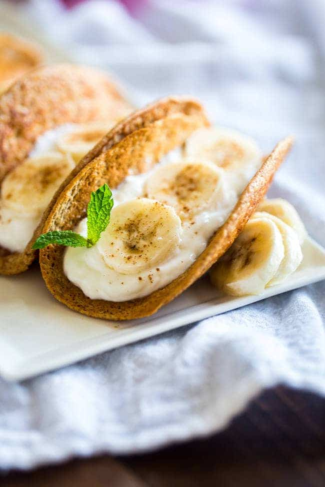 Greek Yogurt Banana Pancake Tacos - These gluten free banana pancakes are filled with Greek yogurt and rolled up like tacos! They're a fun, healthy breakfast for only 100 calories per taco! | Foodfaithfitness.com | @FoodFaithFit