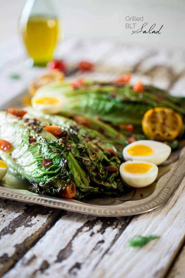 BLT Grilled Wedge Salads with Lemon Dill Vinaigrette - Grilled romaine hearts are tossed with turkey bacon, tomato, soft boiled eggs and a creamy, homemade lemon dill dressing! It's a low carb, healthy summer meal for 300 calories! | Foodfaithfitness.com | @FoodFaithFit