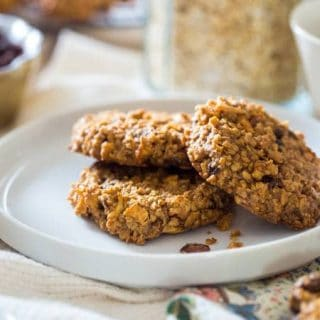 Apple Raisin Breakfast Cookie s - These easy, one-bowl breakfast cookies are made with oatmeal, apples, raisins and almond butter for a healthy, vegan & gluten free breakfast. They're perfect for busy mornings! | Foodfaithfitness.com | @FoodFaithFit