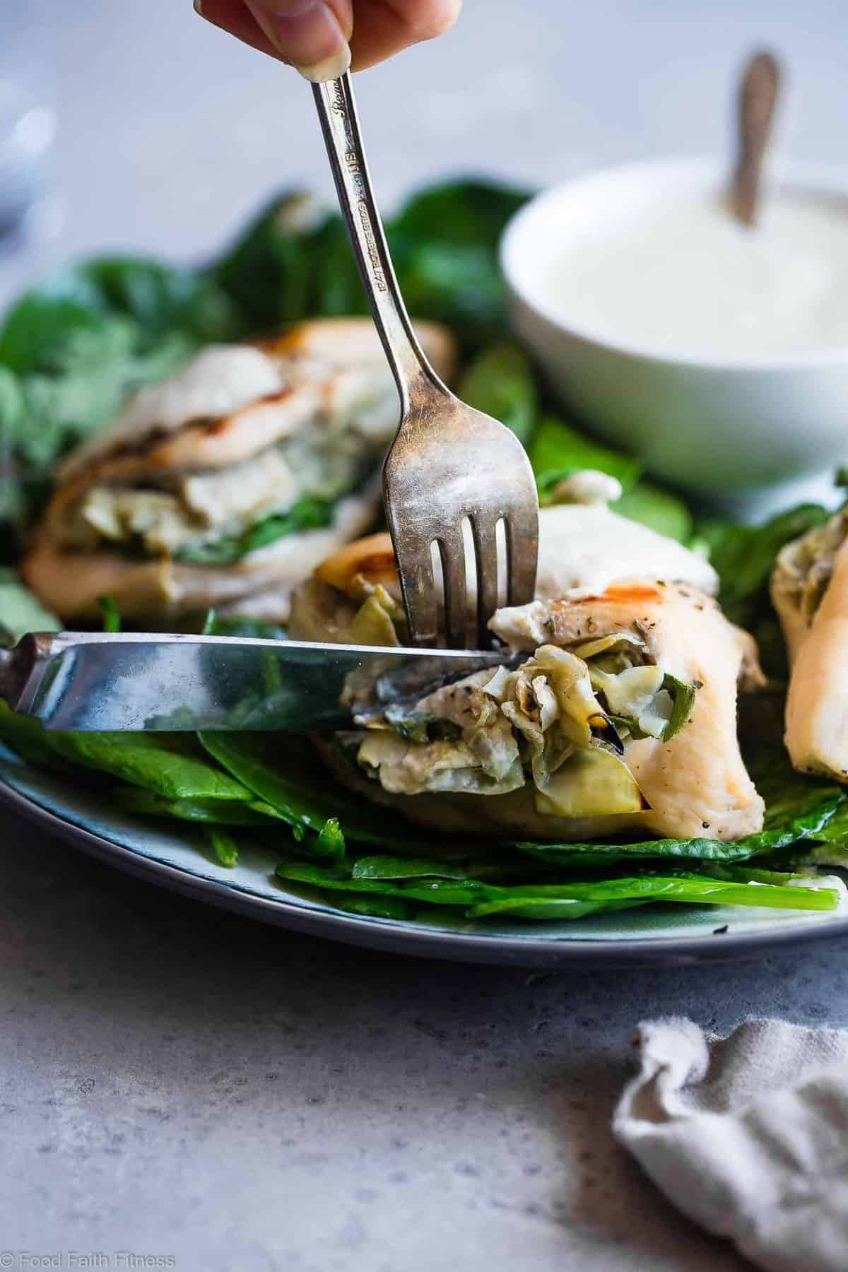 Spinach Artichoke Greek Yogurt Chicken - Chicken is stuffed, grilled and topped with a creamy, Parmesan Greek yogurt sauce! It's a healthy, low carb dinner that's perfect for a weeknight, and only 1 WW Freestyle point! | #Foodfaithfitness | #GreekYogurt #LowCarb #Healthy #Glutenfree #ChickenDinner