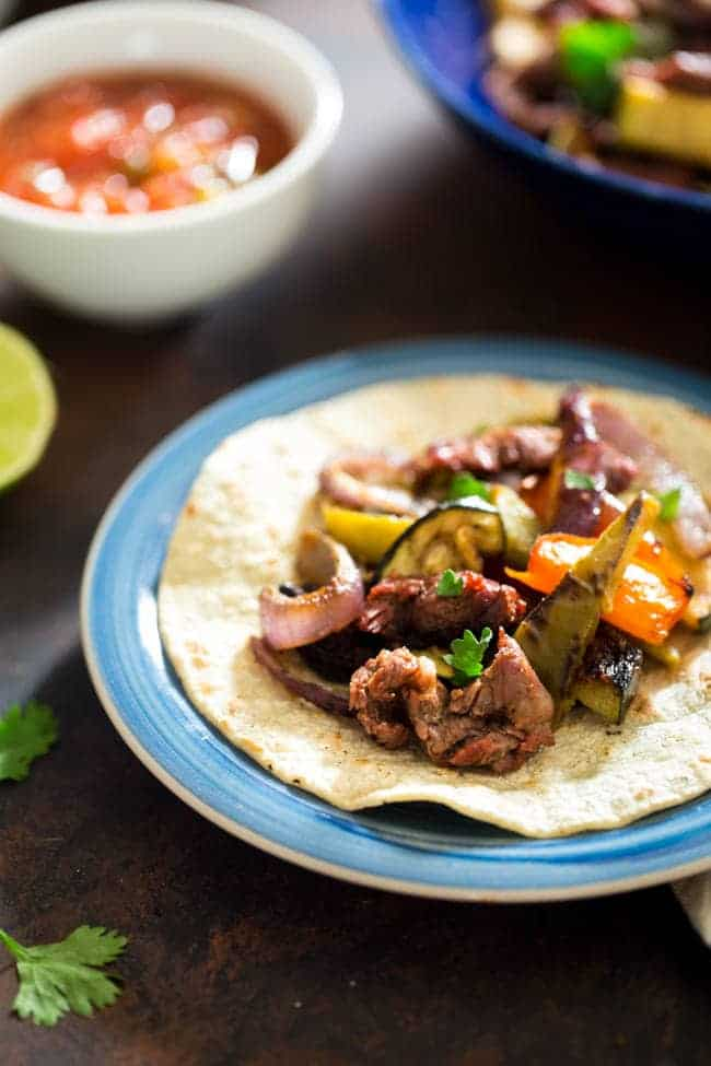 Fall Vegetable Fajitas - These vegetable fajitas are grilled with tender, thinly-cut steak and a spicy marinade. They're a quick and easy, healthy dinner that the family will love! | Foodfaithfitness.com | @FoodFaithFit