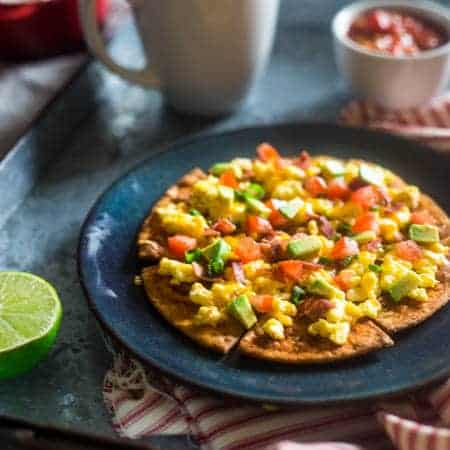 Homemade Healthy Breakfast Nachos - These spicy, healthy nachos are loaded with bacon, scrambled eggs, cheese and a Greek yogurt salsa for an easy, high protein & gluten free breakfast! | Foodfaithfitness.com | @FoodFaithFit