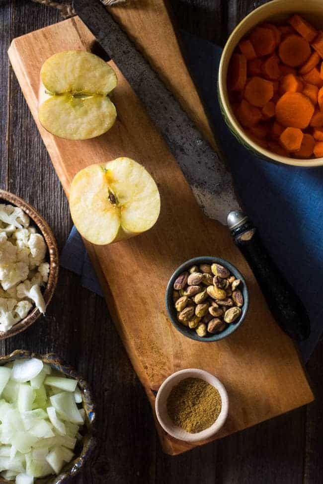 Vegan + Paleo Moroccan Apple, Carrot and Pistachio Cauliflower Soup - This easy, healthy soup is blended with spicy Moroccan flavors, carrots, apples and pistachio cream for an easy, vegan and paleo-friendly fall meal!   Foodfaithfitness.com   @FoodFaithFit
