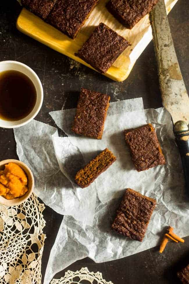 Paleo Pumpkin Cake Bars - These secretly healthy cake bars are made in one bowl and are gluten-free, paleo friendly and only 110 calories! They're a fall dessert that's always a crowd pleaser! | Foodfaithfitness.com | @FoodFaithFit