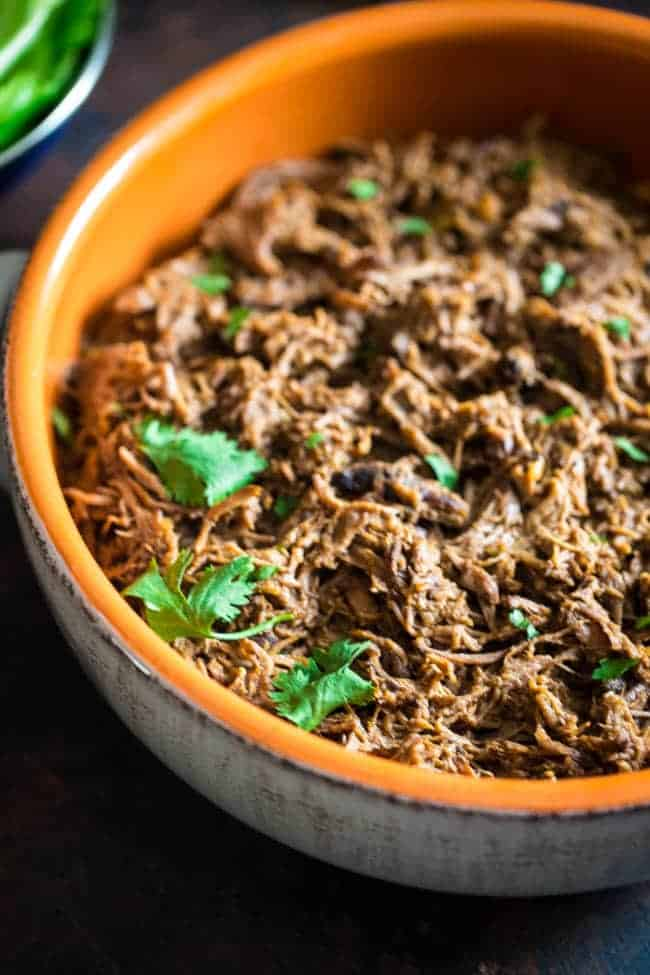 Paleo Pumpkin Salsa Shredded Slow Cooker Roast Beef - Roast beef is mixed with pumpkin and salsa, and then slow cooked until tender and juicy! Shred it up and it's perfect in tacos or on a salad for a healthy, weeknight meal! | Foodfaithfitness.com | @FoodFaithFit