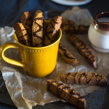 Gluten Free Gingerbread Biscotti - These gluten free biscotti are made with oat flour and have a spicy, sweet Gingerbread taste! They're a healthy Christmas cookie that are only 106 calories! | Foodfaithfitness.com | @FoodFaithFit