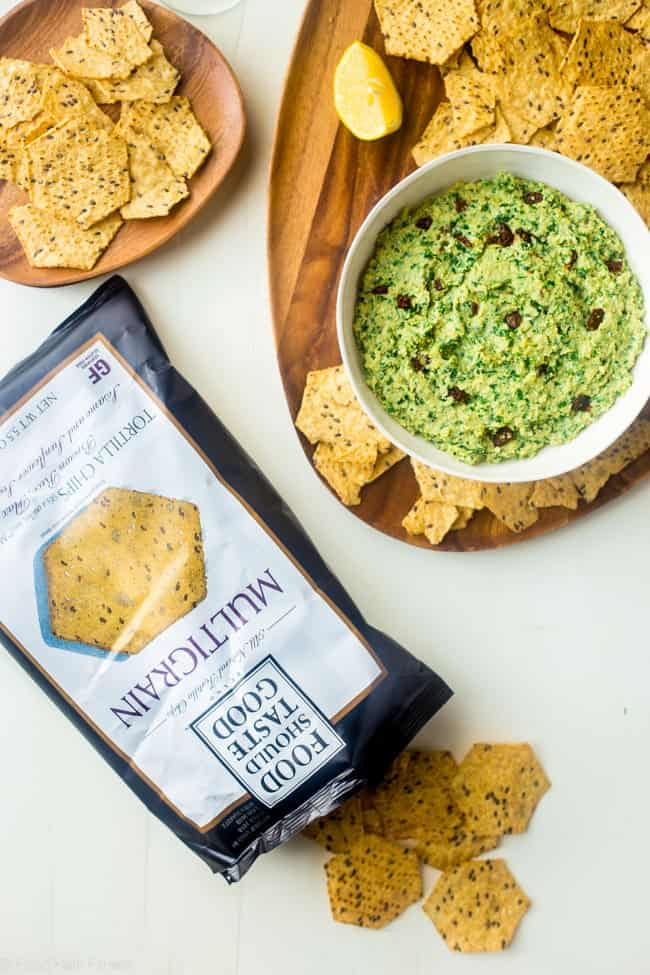 Vegan Kale Pesto and Sun-dried Tomato Hummus - This quick and easy, vegan homemade hummus features kale pesto and sun dried tomatoes. It's a healthy, gluten free appetizer or snack! | Foodfaithfitness.com | @FoodFaithFit