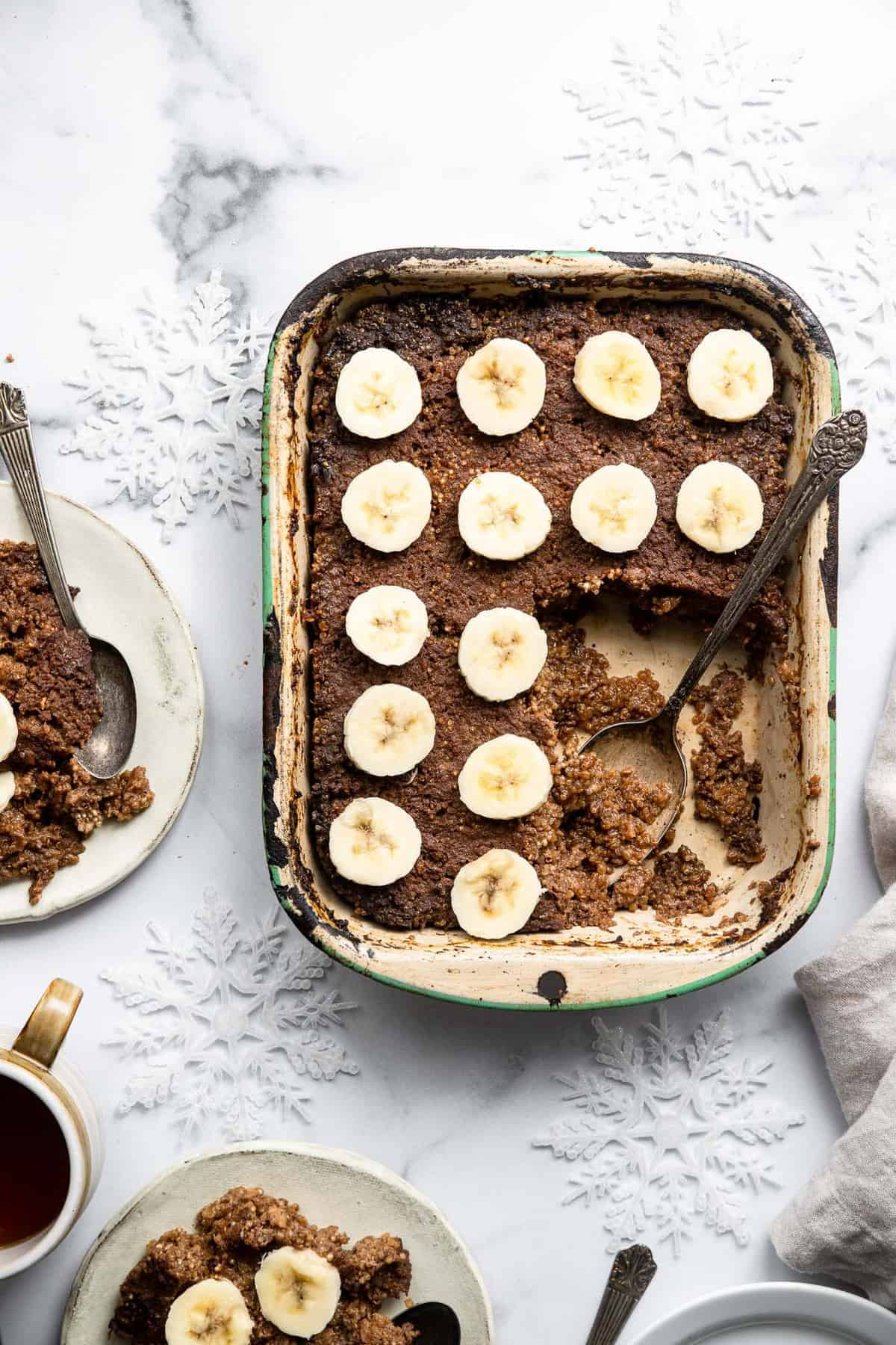 a pan of quinoa breakfast bake with a plate beside it