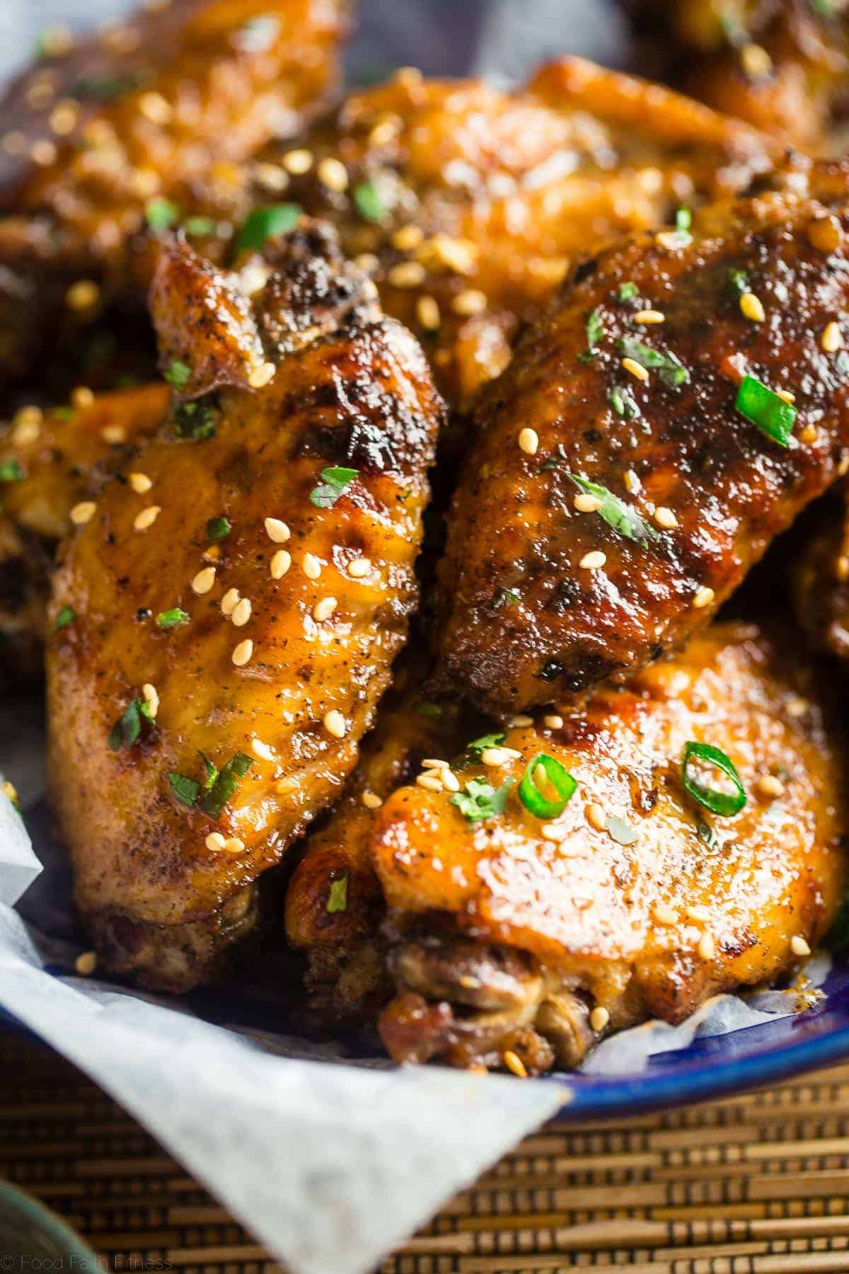 Whole30 Sticky Pineapple 5 Spice Slow Cooker Chicken Wings - Let the slow cooker do the work for you with these Asian-inspired chicken wings! You'll never know they're secretly whole30 and paleo compliant! Perfect for game day! | Foodfaithfitness.com | @FoodFaithFit