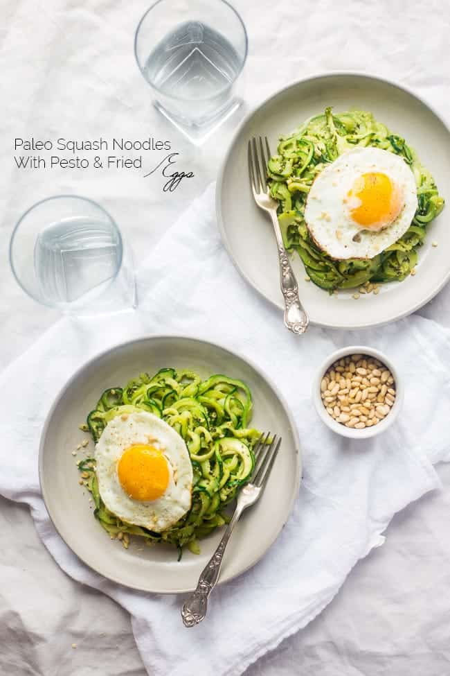 Whole30 Paleo Zucchini Noodles with Everything Pesto and Fried Eggs - Zucchini noodles are mixed with creamy pesto and then topped with fried eggs. It's an easy, light and healthy, meatless weeknight dinner! | Foodfaithfitness.com | @FoodFaithFit