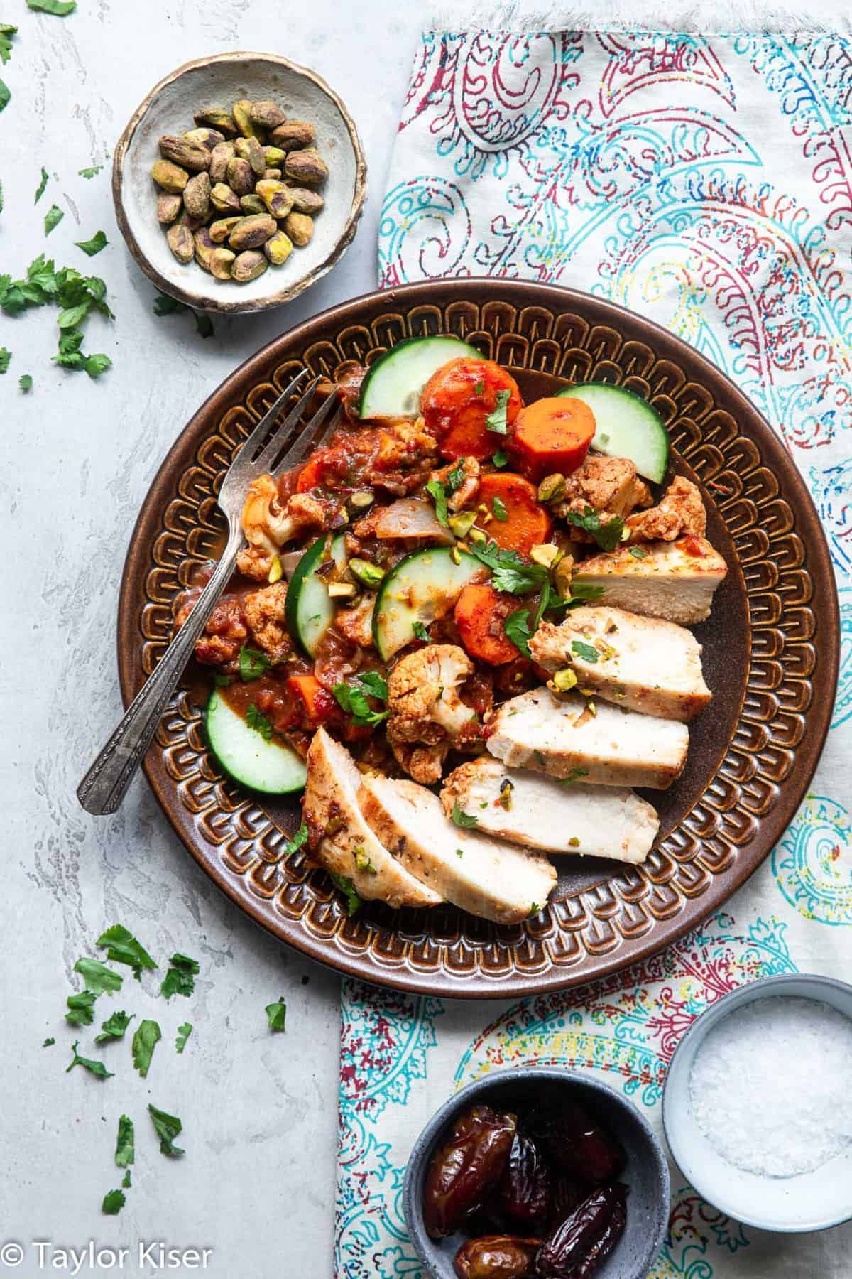 Moroccan Chicken on a plate with pistachios