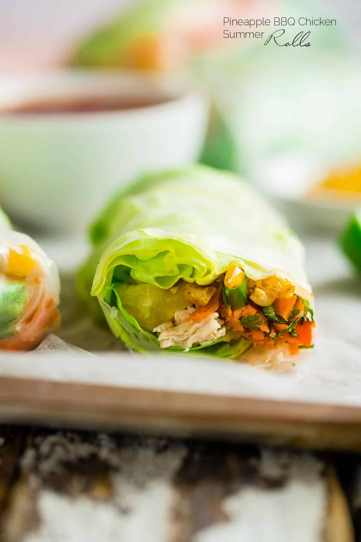 Healthy BBQ Chicken Summer Rolls - The classic Thai Summer Rolls get a fun, gluten free makeover with chicken, homemade BBQ sauce and sweet pineapple. Perfect for a light dinner or to serve on game day! | Foodfaithfitness.com | @FoodFaithFit