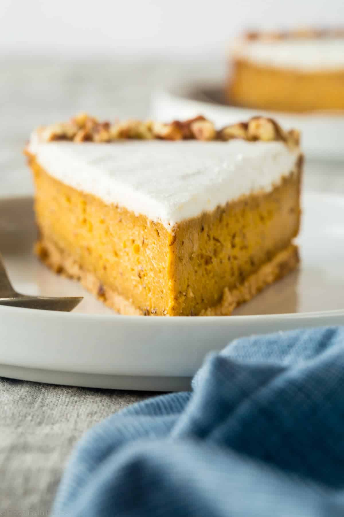 Gluten Free Paleo And Vegan Carrot Cake Cheesecake - This super easy, rich, creamy, paleo and vegan friendly cheesecake tastes like carrot cake but is secretly dairy, gluten, egg and refined sugar free and healthy! Perfect for Easter! | Foodfaithfitness.com | @FoodFaithFit