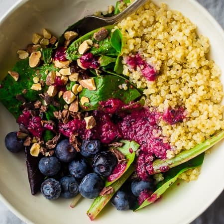 Vegan Blueberry Cacao Superfood Quinoa Salad - This healthy quinoa salad recipe has almonds, cacao nibs and a blueberry vinaigrette. It's an easy, gluten free and vegan meal that's packed with superfoods for only 360 calories!| Foodfaithfitness.com | @FoodFaithFit