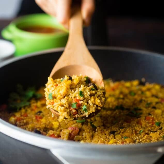"Vegan ""Cheesy"" Mexican Quinoa - This easy, one-pan meal has a spicy, cheesy taste - without the cheese! It's a healthy and gluten free, vegan-friendly weeknight meal that is under 300 calories! 