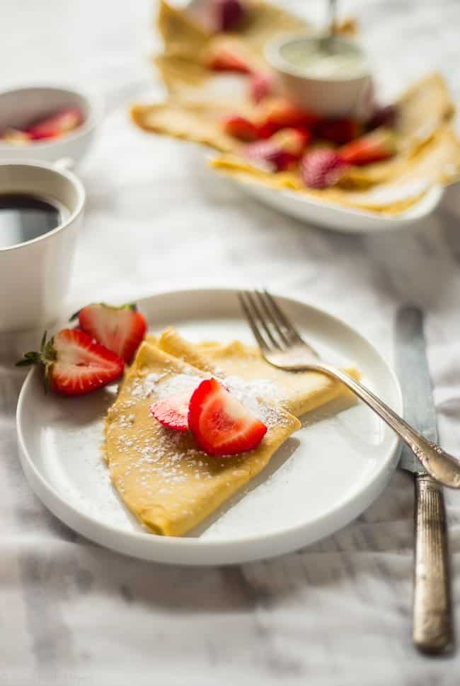 Paleo Crepes - These gluten free, paleo crepes are SO easy to make. Stuff them with your favorite fillings for a healthy breakfast or brunch that's only 75 calories and 3 SmartPoints!   Foodfaithfitness.com   @FoodFaithFit