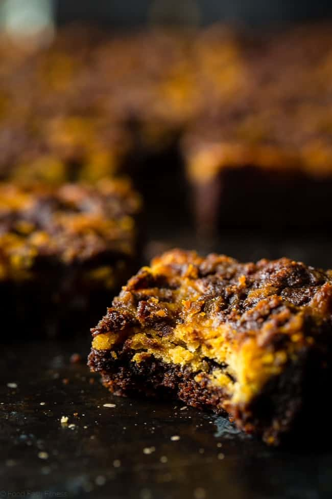 Vegan Peanut Butter Cookie Dough Stuffed Brownies - You'll never believe these dense, chewy vegan brownies are completely oil and butter free, and are a healthy, gluten free treat for only 150 calories! | Foodfaithfitness.com | @FoodFaithFit