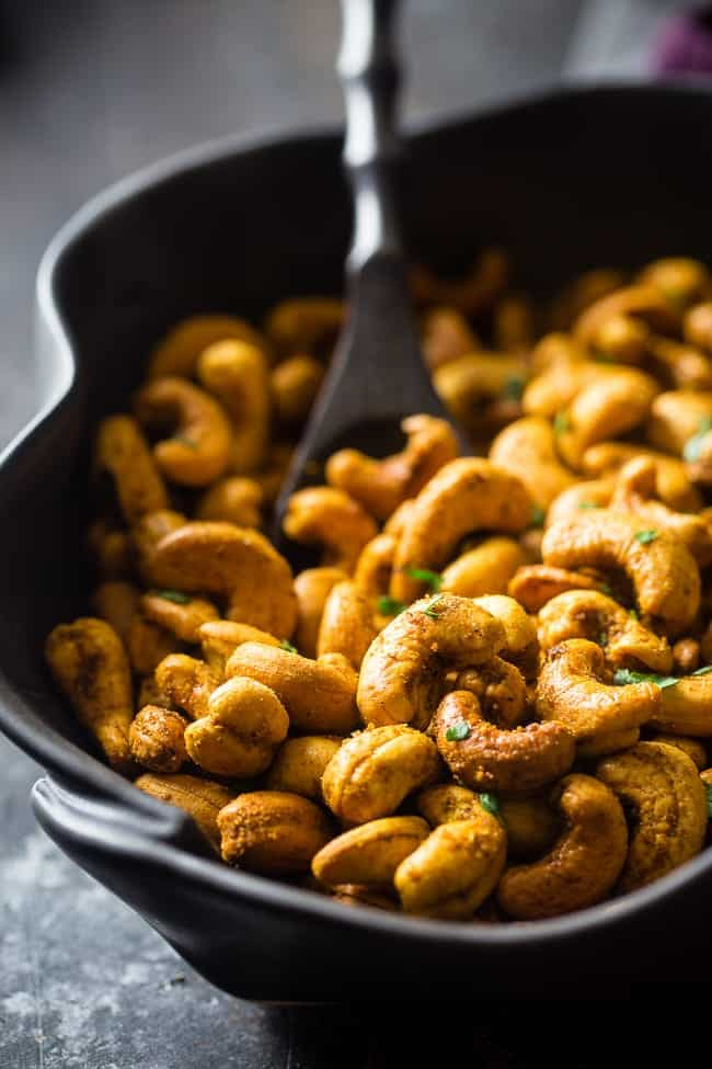 Thai Curry Roasted Cashews - These gluten free, 4 ingredient roasted cashews have a spicy-sweet Thai curry kick! They're a quick and easy, paleo and vegan friendly and snack for on the go eating! | Foodfaithfitness.com | @FoodFaithFit