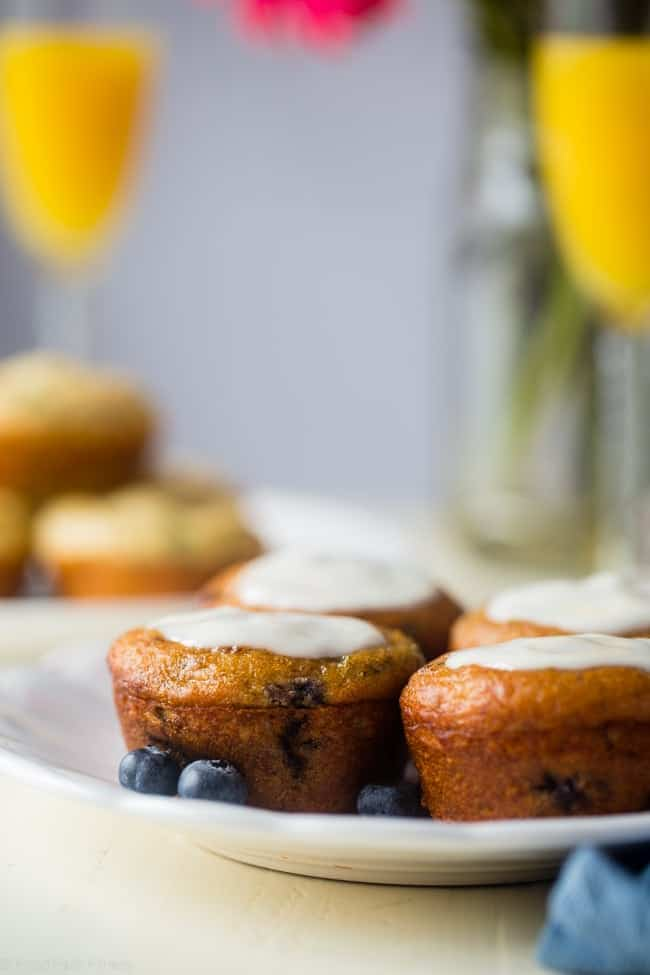 Gluten Free Blueberry Basil and Tomato Goat Cheese Muffins - These unique healthy blueberry muffins use basil for some spring flavor! The sun dried tomato version has creamy bursts of goat cheese in every bite! They're both gluten/oil free, protein packed and perfect for brunch! | Foodfaithfitness.com | @FoodFaithFit