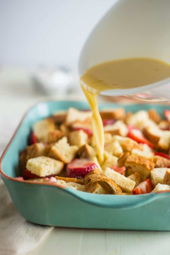 Gluten Free Strawberry Rhubarb French Toast Bake - This easy french toast bake is bursting with sweet strawberries and tangy rhubarb. It's a perfect, make-ahead spring breakfast or brunch!   Foodfaithfitness.com   @FoodFaithFit