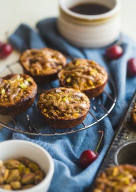 Almond, Cherry and Apricot Quinoa Muffins - These spicy-sweet, healthy quinoa muffins are packed with roasted cherries and apricots! They're an easy, portable breakfast or snack that's gluten free and kid friendly!   Foodfaithfitness.com   @FoodFaithFit
