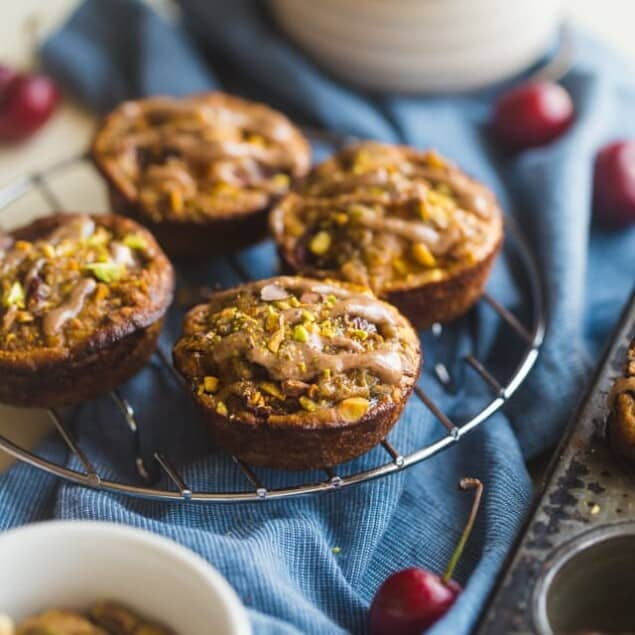 Almond, Cherry and Apricot Quinoa Muffins - These spicy-sweet, healthy quinoa muffins are packed with roasted cherries and apricots! They're an easy, portable breakfast or snack that's gluten free and kid friendly! | Foodfaithfitness.com | @FoodFaithFit