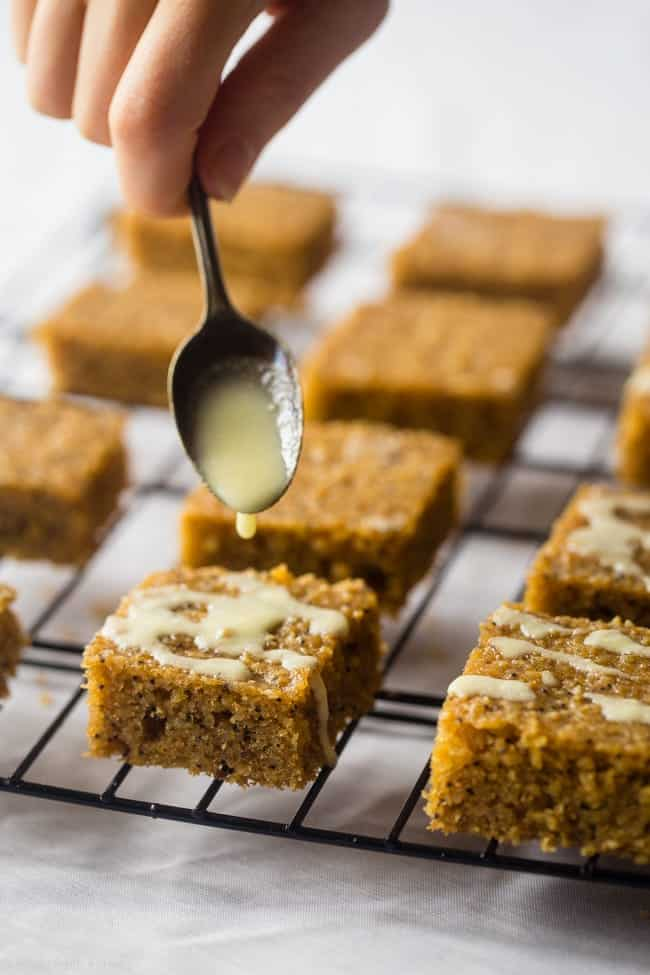 Gluten Free Slower Cooker Lemon Poppy Seed Cake Bars - These easy, low carb cake bars are made in the slow cooker! They're soft, chewy and secretly healthy, gluten/grain free and packed with protein! | Foodfaithfitness.com | @FoodFaithFit