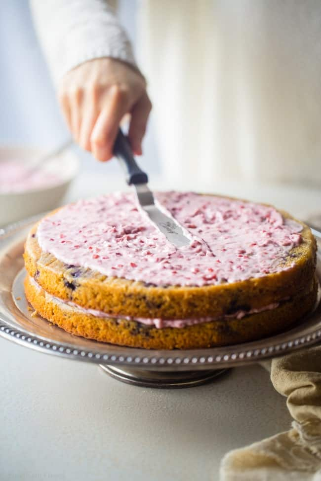 Paleo Blueberry Cake with Raspberry Coconut Cream - This layered paleo cake has fresh, juicy blueberries and raspberry coconut whipped cream! It's a healthier, gluten free dessert that's perfect for summer! | Foodfaithfitness.com | @FoodFaithFit