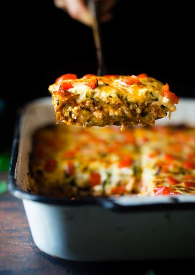 Mexican Zucchini Lasagna - This lasagna has all the cheesy, saucy taste but without the carbs and calories! It's a healthy, gluten free and protein-packed crowd-pleasing dinner that's only 280 calories! Make-ahead and freezer friendly too! | Foodfaithfitness.com | @FoodFaithFit