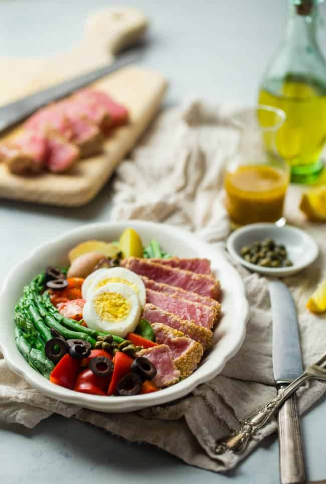 Whole30 Asian Nicoise Salad - This salad is healthy spin on the classic that uses a sesame ginger vinaigrette and seared tuna steaks for a healthy, Whole30 compliant, paleo-friendly meal that's packed with protein! | Foodfaithfitness.com | @FoodFaithFit