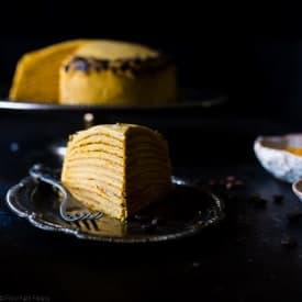 Vegan Pumpkin Spice Latte Crepe Cake - This Vegan Crepe Cake tastes like a pumpkin spice latte with a touch of coconut! It's an impressive, gluten free dessert for the holidays that's under 250 calories a slice! | Foodfaithfitness.com | @FoodFaithFit