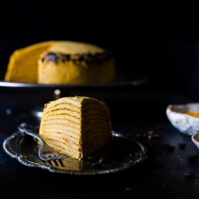 Vegan Pumpkin Spice Latte Crepe Cake - This Vegan Crepe Cake tastes like a pumpkin spice latte with a touch of coconut! It's an impressive, gluten free dessert for the holidays that's under 250 calories a slice!   Foodfaithfitness.com   @FoodFaithFit