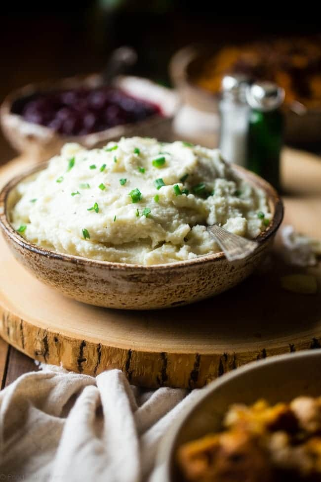 5 Ingredient Cauliflower Mashed Potatoes - This quick and easy mashed cauliflower only has 5 ingredients, 62 calories, 1 SmartPoint and use a secret ingredient to pack them with protein! Perfect for a healthy Thanksgiving! | Foodfaithfitness.com | @FoodFaithFit