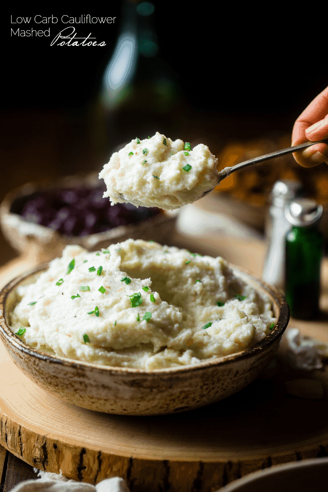 5 Ingredient Cauliflower Mashed Potatoes - These quick and easy, low carb cauliflower mashed potatoes only have 5 ingredients, 62 calories, 1 SmartPoint and use a secret ingredient to pack them with protein! Perfect for a healthy Thanksgiving! | Foodfaithfitness.com | @FoodFaithFit