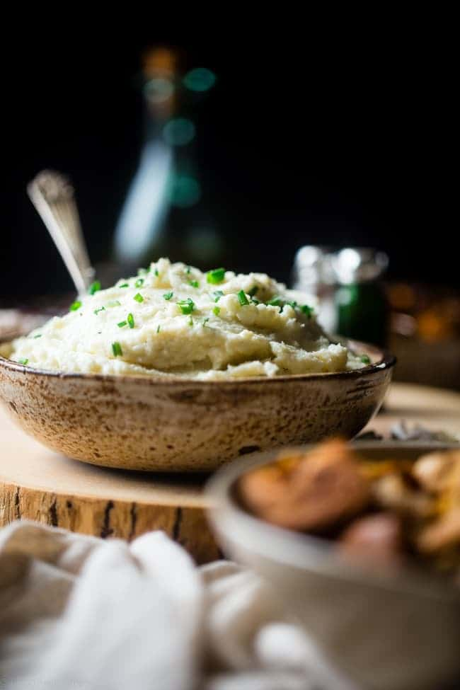 5 Ingredient Cauliflower Mashed Potatoes - These quick and easy, low carb and gluten free cauliflower mashed potatoes only have 5 ingredients, 62 calories, 1 SmartPoint and use a secret ingredient to pack them with protein! Perfect for a healthy Thanksgiving! | Foodfaithfitness.com | @FoodFaithFit