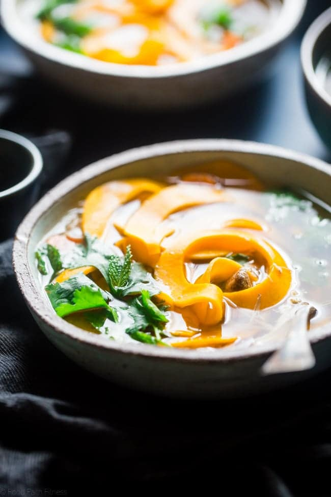 Thai Crockpot Paleo Chicken Noodle Soup - This easy paleo soup is a Thai twist on the classic with butternut squash noodles so it's gluten free, under 300 calories and 3 SmartPoints! A low-carb option is included! | Foodfaithfitness.com | @FoodFaithFit