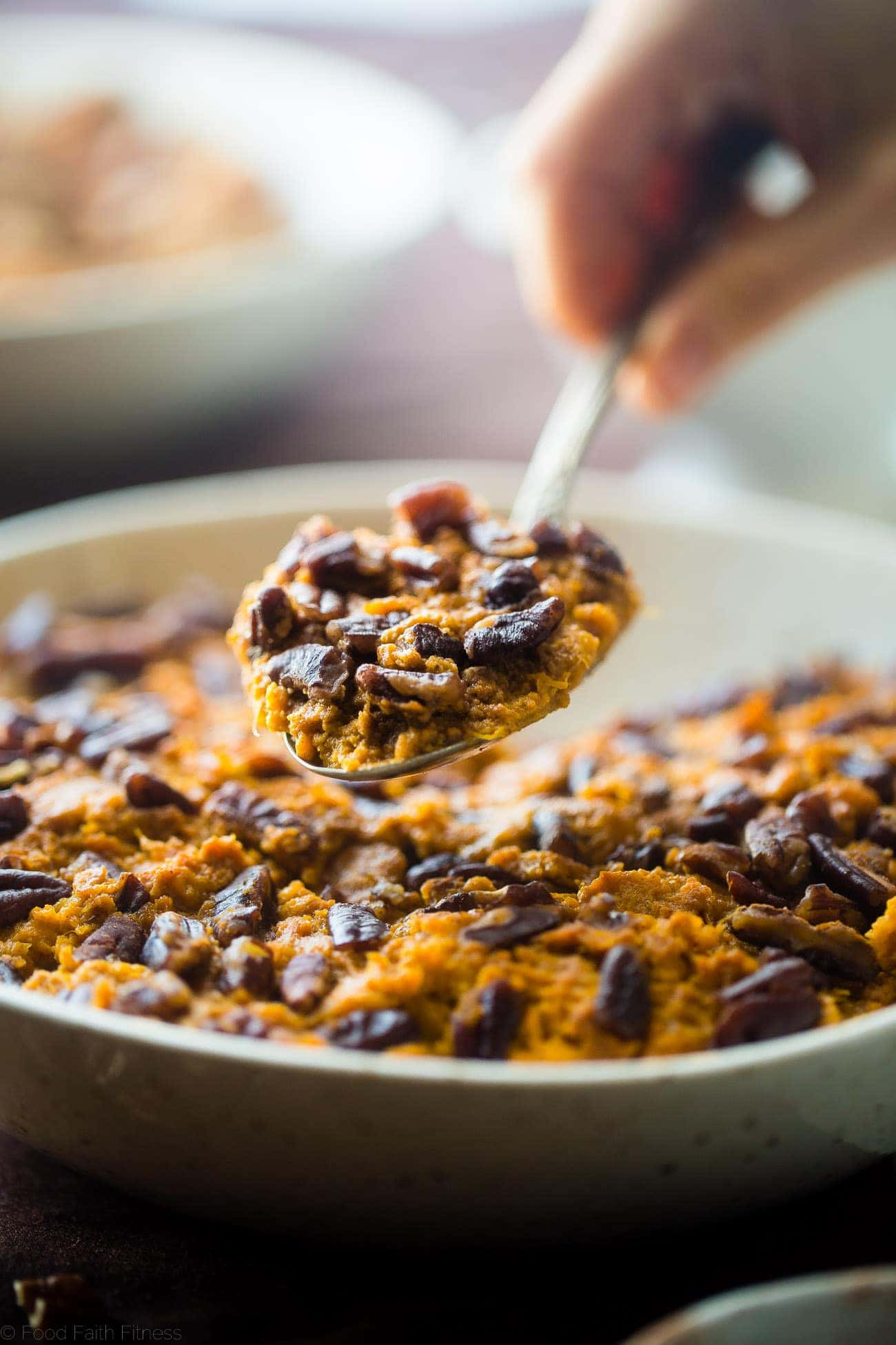 Slow Cooker Paleo Healthy Sweet Potato Casserole - Let the slow cooker do all the work for you this Thanksgiving with this quick and easy paleo sweet potato casserole! You won't even miss the marshmallows! | Foodfaithfitness.com | @FoodFaithFit