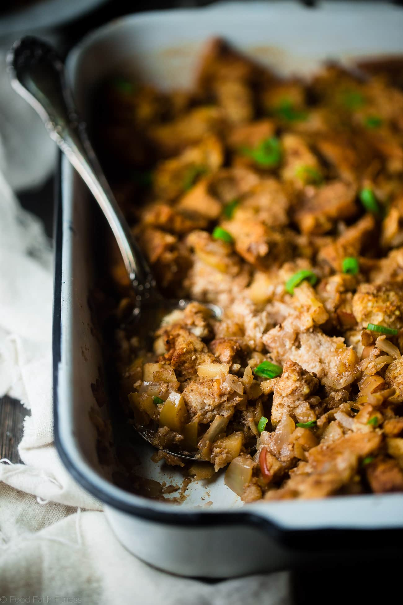 Gluten Free Apple Raisin Stuffing - This easy, gluten free stuffing is made from a mixture of bread and cinnamon raisin bagels! It's the perfect simple, healthy Thanksgiving side dish that everyone will love!   Foodfaithfitness.com   @FoodFaithFit