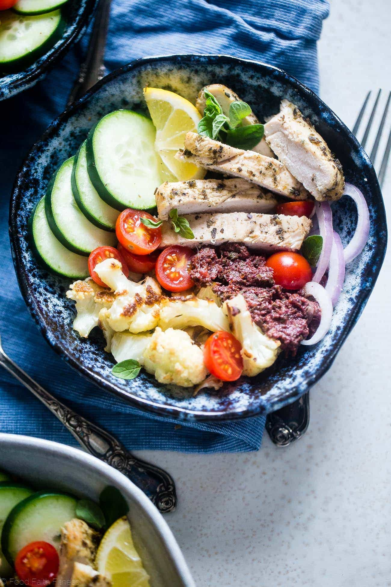 Greek Chicken Meal Prep Bowls - These low carb chicken bowls have roasted cauliflower and an olive tapenade. They're an easy, whole30 compliant, paleo meal that you can prep ahead, and their only 300 calories! | Foodfaithfitness.com | @FoodFaithFit