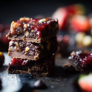 Strawberry Chocolate Paleo Magic Cookie Bars - These magic cookie bars have a sweet strawberry swirl and are SO easy to make! They're a healthy, vegan friendly and gluten free remake of the classic recipe that everyone will love! | Foodfaithfitness.com | @FoodFaithFit