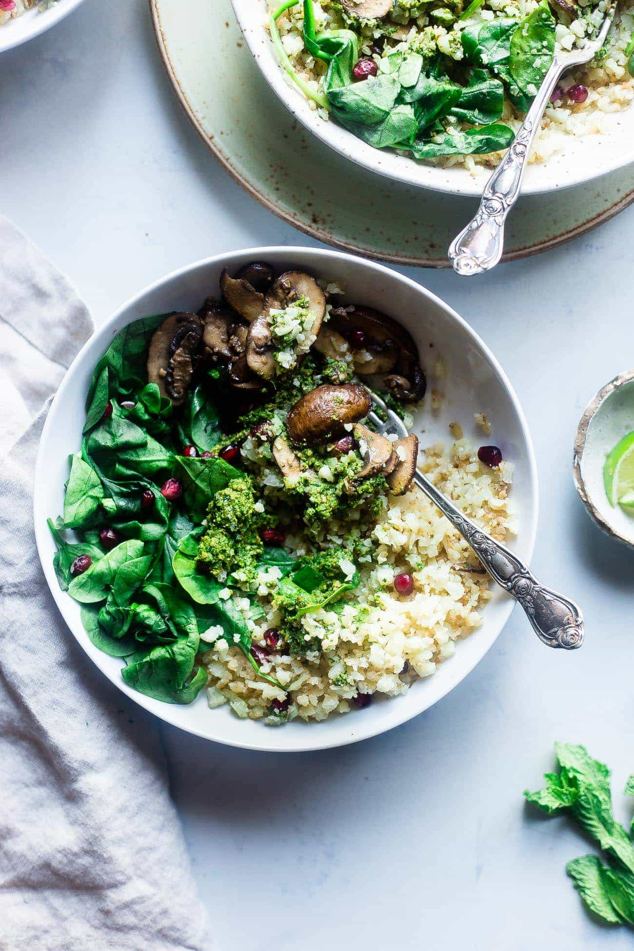 Vegan Detox Cauliflower Bowls - These low carb bowls are packed with veggies and a delicious almond pesto! They're a whole30 compliant, vegan and paleo friendly meal that is only 200 calories! | Foodfaithfitness.com | @ FoodFaithFit