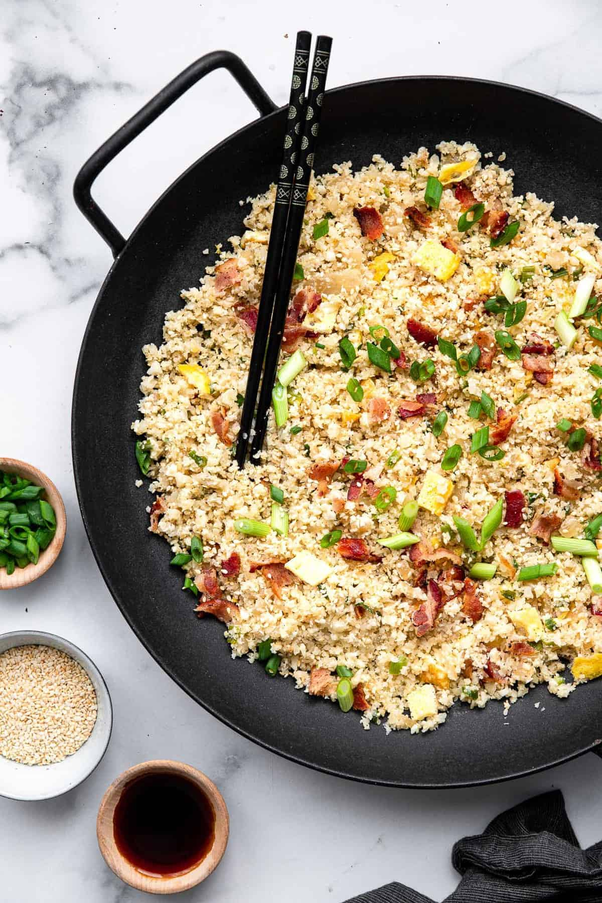 whole30 cauliflower fried rice in a wok