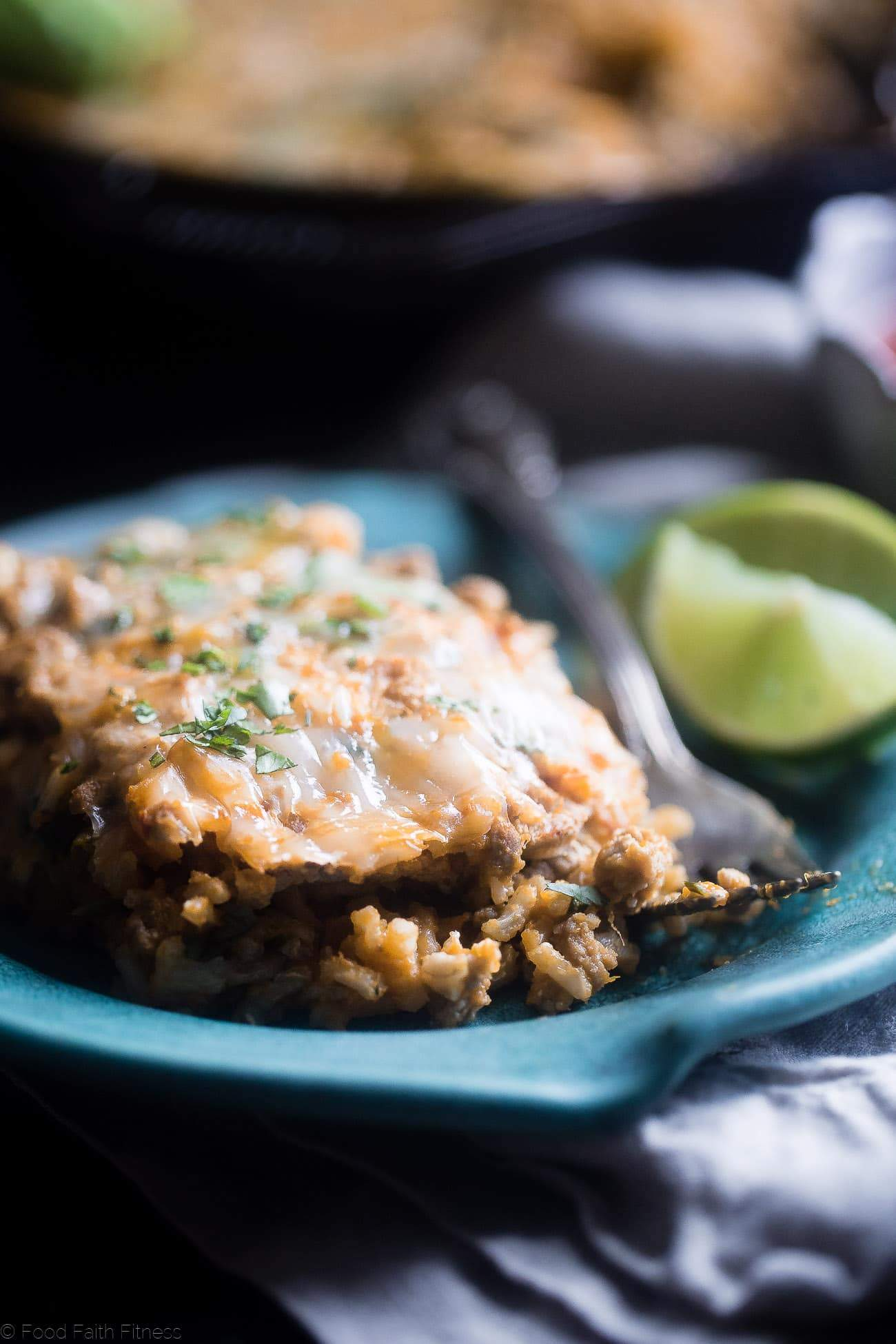 One Pot Mexican Chicken Rice Casserole - This chicken Mexican rice casserole uses sweet potato for extra creaminess! It's a healthy, gluten free, 8 ingredient dinner for busy weeknights that is only 330 calories!   Foodfaithfitness.com   @FoodFaithFit