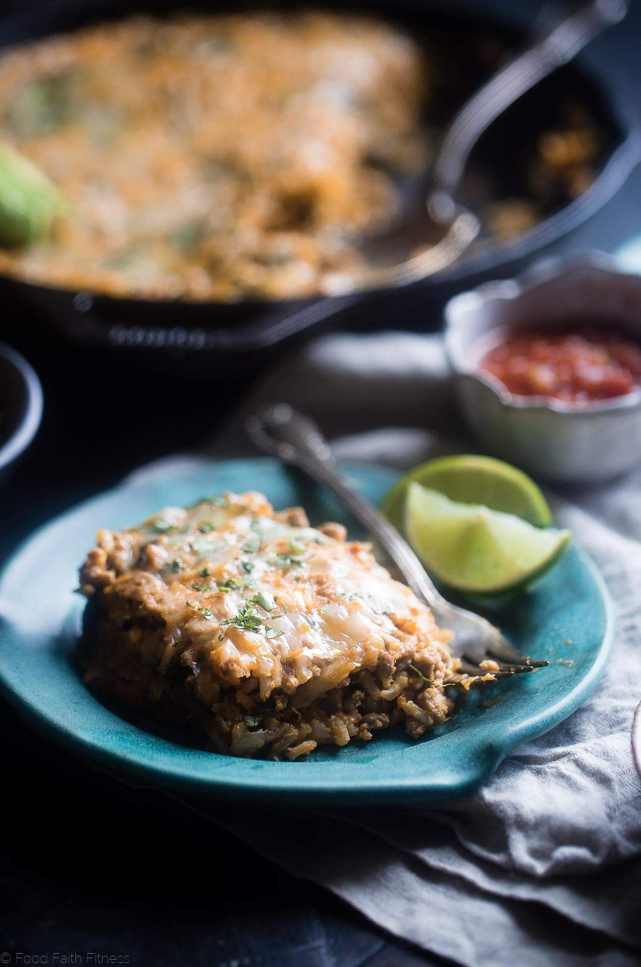 One Pot Mexican Chicken Rice Casserole - This chicken Mexican rice casserole uses sweet potato for extra creaminess! It's a healthy, quick and easy, 8 ingredient dinner for busy weeknights that is only 330 calories!   Foodfaithfitness.com   @FoodFaithFit