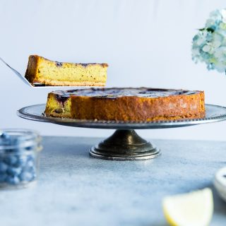 Blueberry Lemon Turmeric Vegan Cheesecake - This easy, paleo friendly cheesecake is made from cashews and has a blueberry swirl! It's so creamy you'll never know it's dairy, grain and gluten free! | Foodfaithfitness.com | @FoodFaithFit
