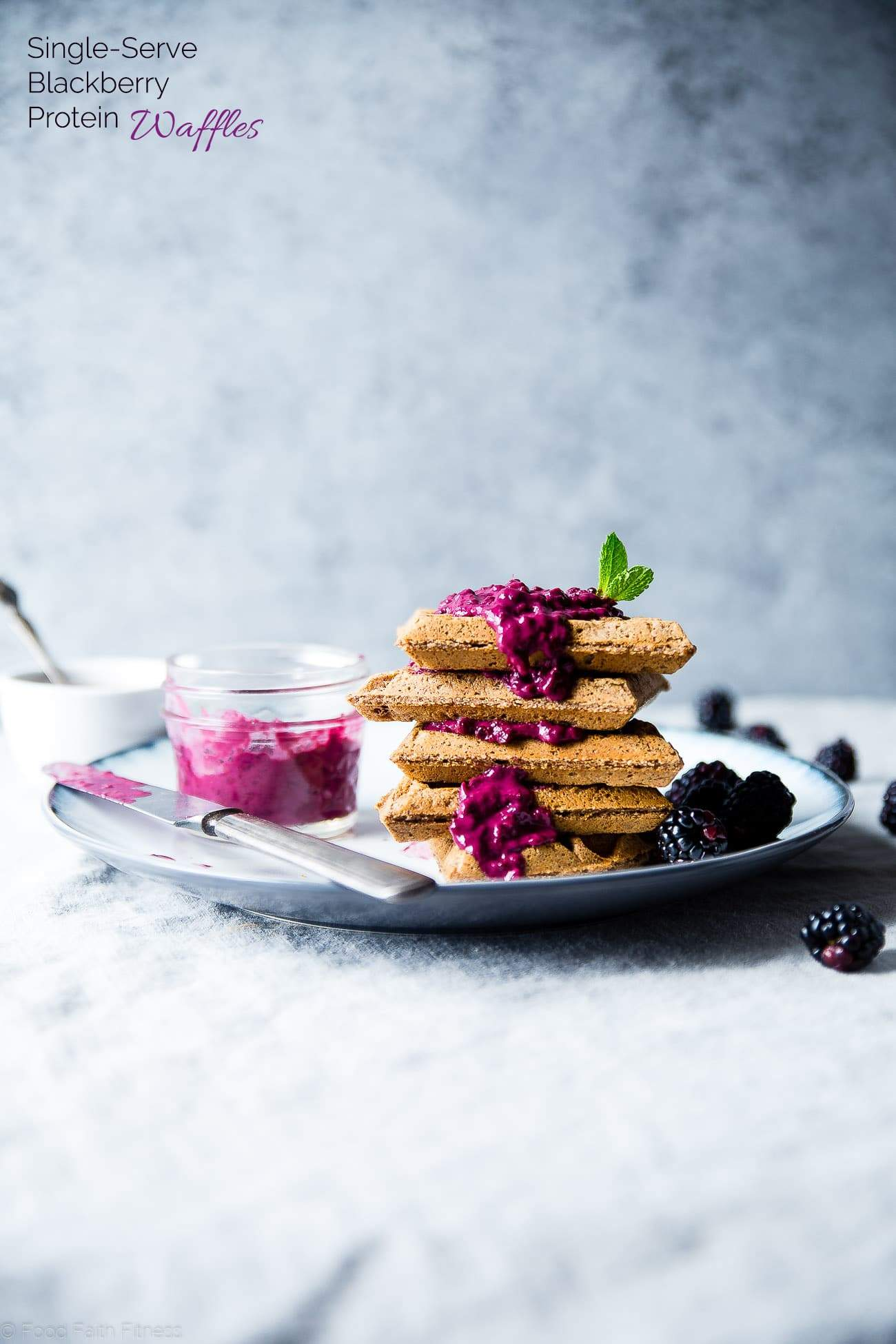 Single Serve Vegan Protein Waffles - These gluten free waffles are ready in only 10 minutes and are packed with healthy, plant-based protein! Top them with blackberry sauce for a delicious breakfast! | Foodfaithfitness.com | @FoodFaithFit