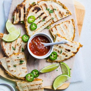 Grilled Mexican Lentil Quesadillas Overhead on a cutting board. Recipe on Foodfaithfitness.com