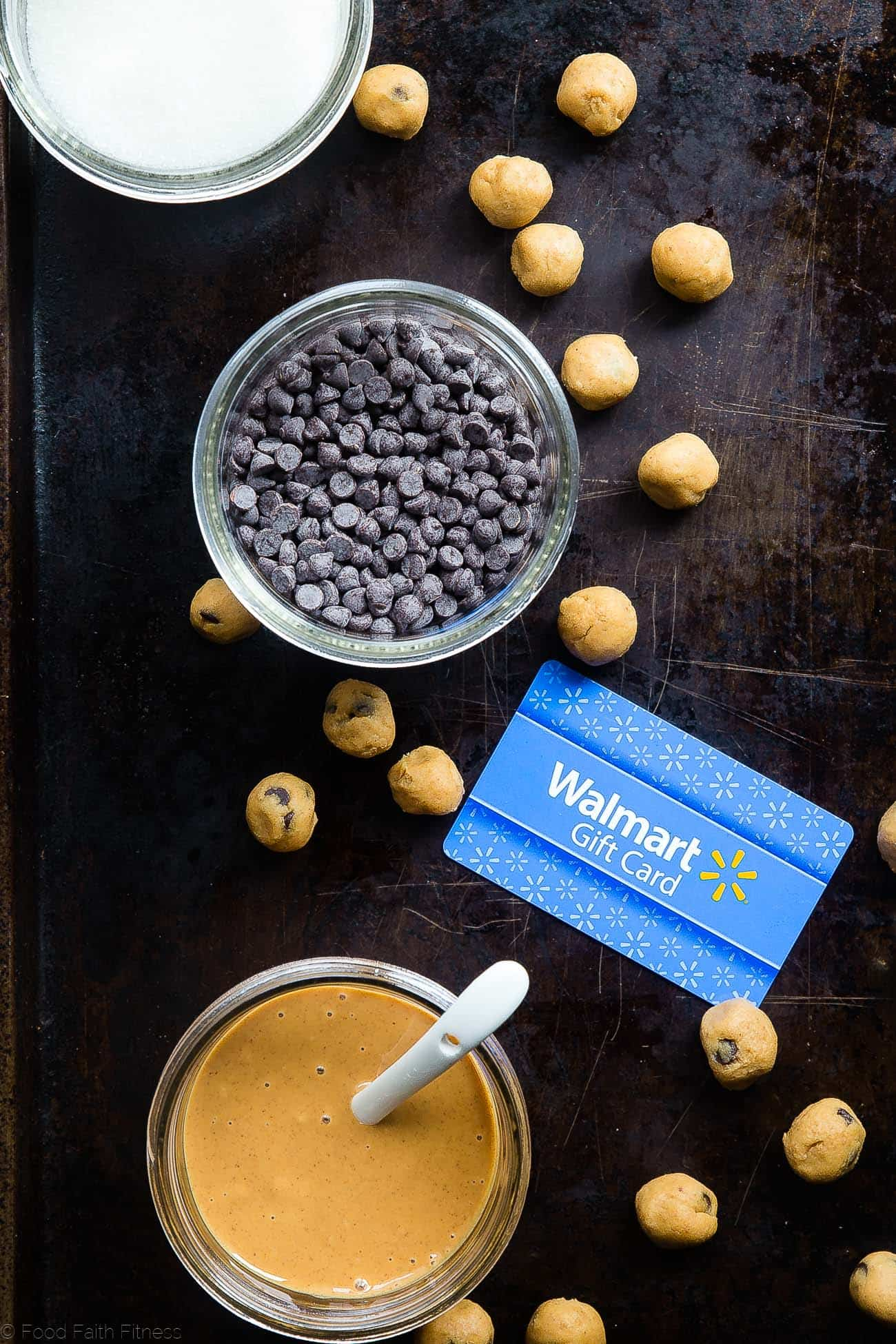 Photo of Walmart card, peanut butter and chocolate chips. Recipe on Foodfaithfitness.com